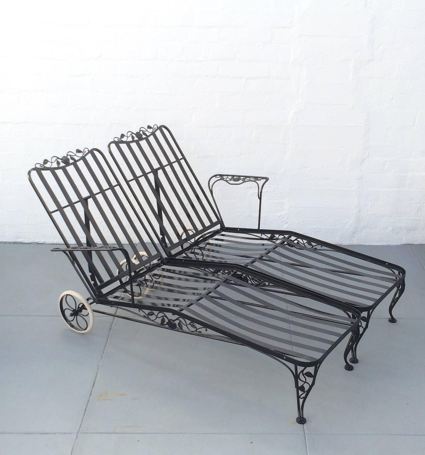 Wrought iron lounge chaise for two designed by russell for Black wrought iron chaise lounge