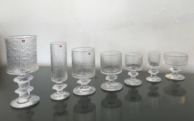 A very glamorous service for eight drink set by Timo Sarpaneva for Iittala. It's very rare to find a hole set together like this. Most of them have Iittala tags or marked TS.  The tallest is 7 7/8 high 3 3/8 diameter. The smallest one is 4 3/8