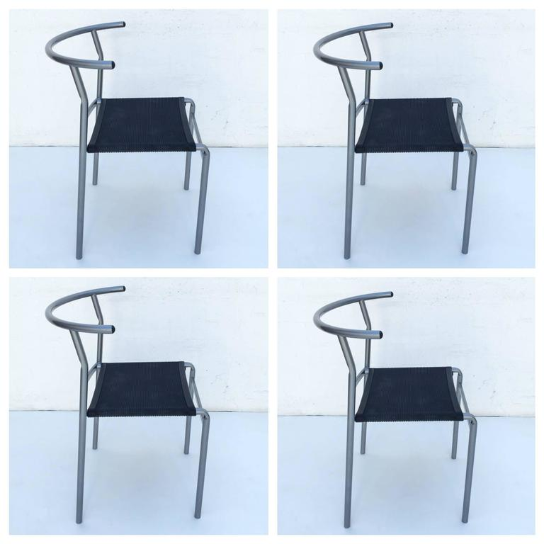 A set of four café chairs designed by Philippe Starck in 1983 for Costa café. This were made by Cerruti Baleri, Italy in 1984. The seat is made out of thick rubber and the frame is steel pipe powder coated silver gray. Newly powder coated.