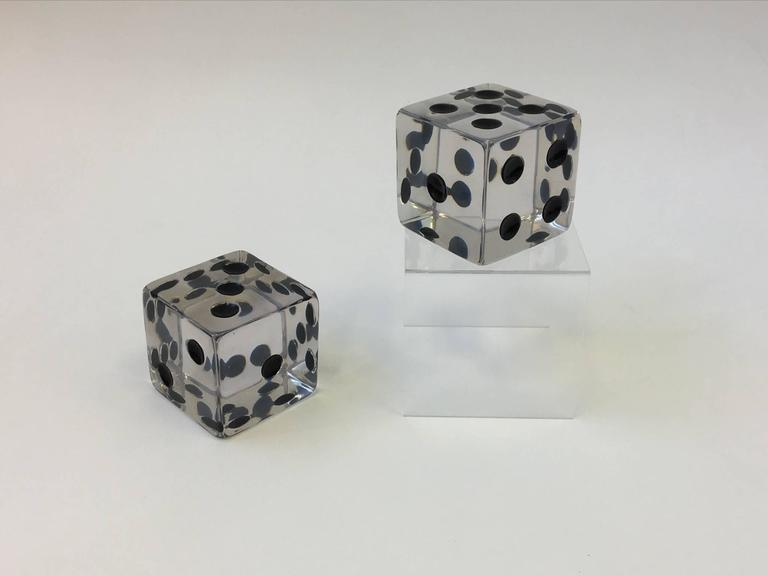 Early edition pair of large Acrylic dice designed by Charles Hollis Jones in the 1970s.  They can be used as bookends or a sculpture.  Dimensions: 3.75