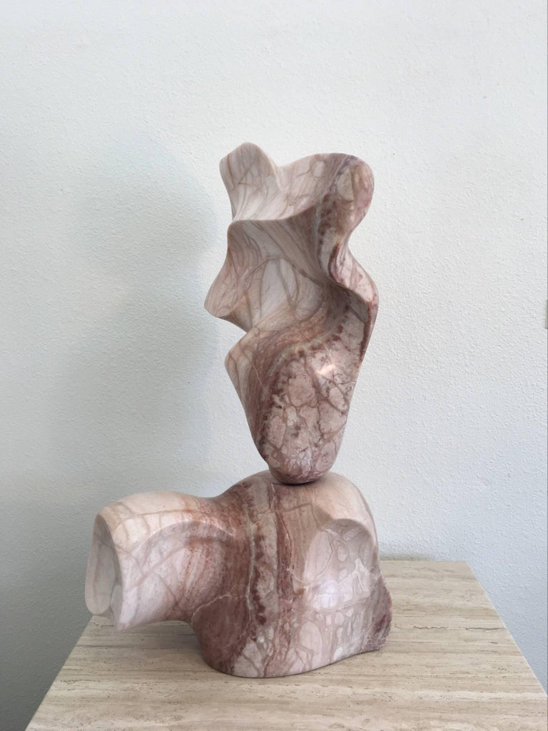 An amazing solid Kinetic marble sculpture from the 1970s. We are not sure on who designed this. The sculpture is in two sections you are able to rotate the top section 360 degrees. The two sections are joined by a solid brass rod. Newly