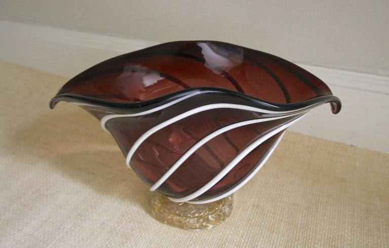 Barovier & Toso Italian handblown glass bowl or centerpiece with clear and gold base and applied lattimo white applied stripes over a rich maroon glass.