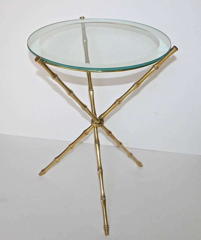 French faux bamboo brass side or occasional table with mirrored edge glass top in the manner of Bagues.