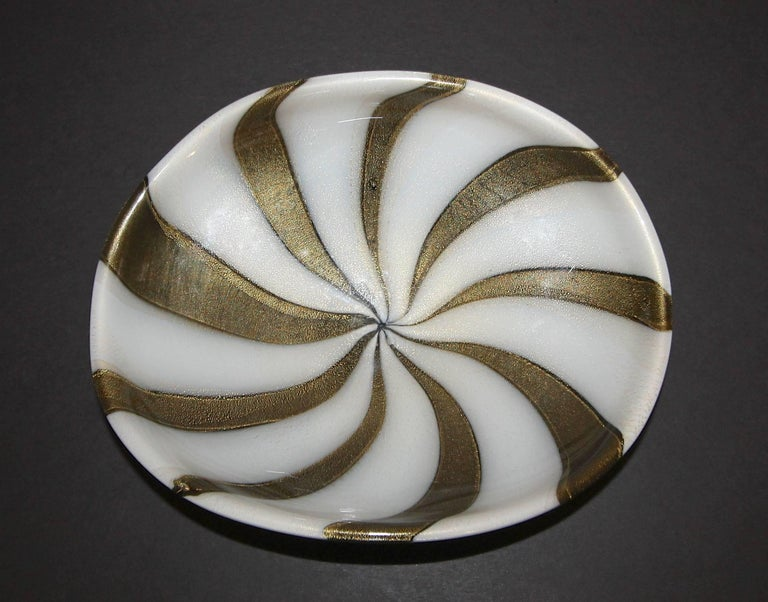 Vintage midcentury Murano Italian handblown circus tent pattern bowl by Alfredo Barbini. Rich brown swirl pattern with gold inclusions against white background and black reverse bottom.