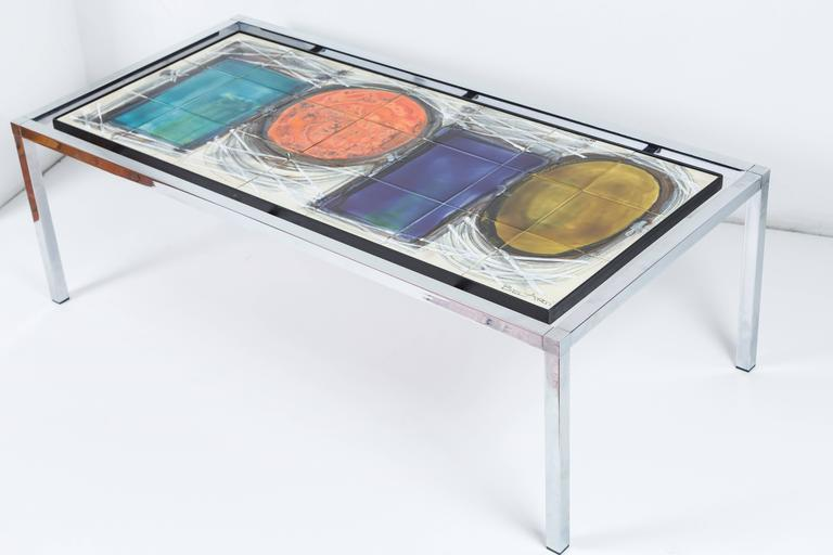 Multicolored ceramic and chrome coffee table by Juliette Belarti.