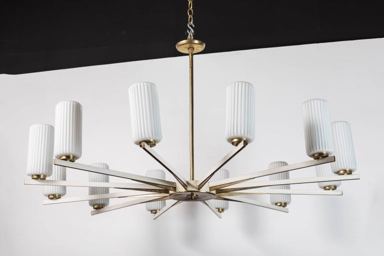 Twelve-light fixture attributed to Stilnovo. Original wear consistent with age.