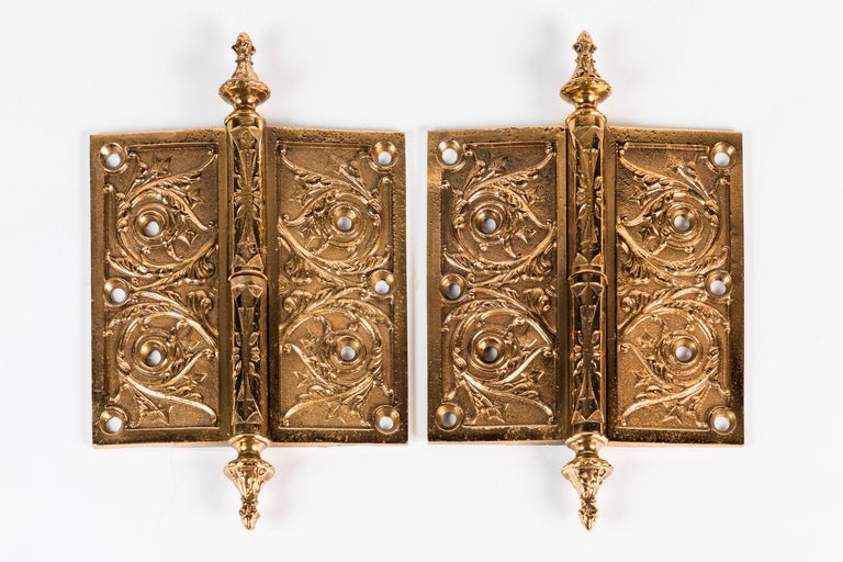 Two elaborate Victorian cast brass hinges; both left handed.