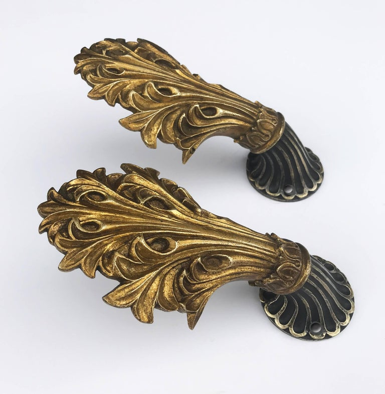 Intricate Victorian cast brass tiebacks. Can also be used as hooks.