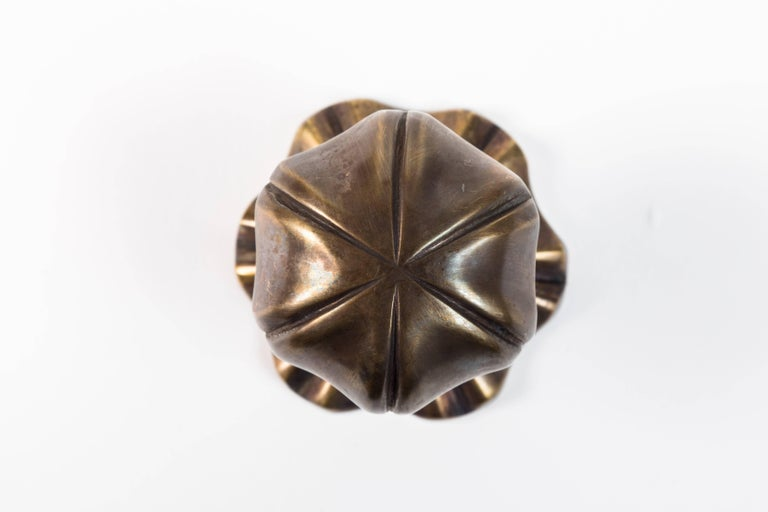 Brass doorknob and rosette set can be surface-mounted or used with a spindle.