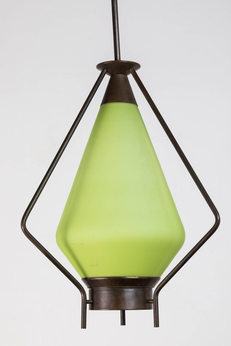 Midcentury green glass and brass pendant.