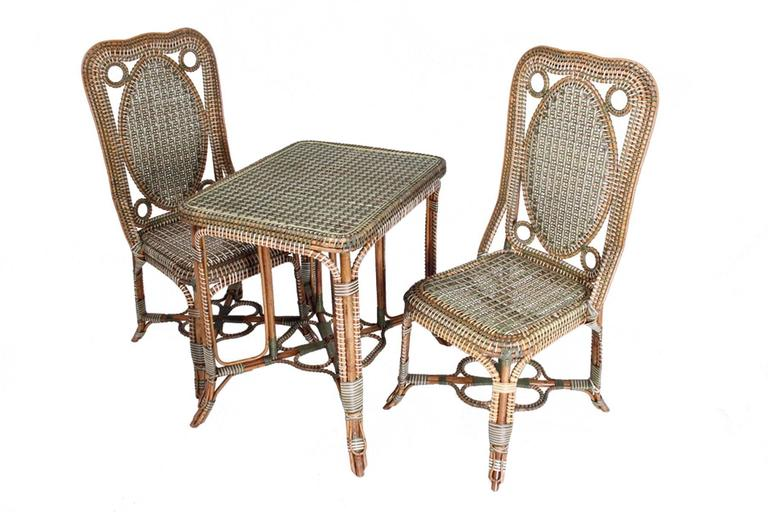 Elegant Set Of Furniture In Braided Rattan Composed Of A Sofa, A Table, Two