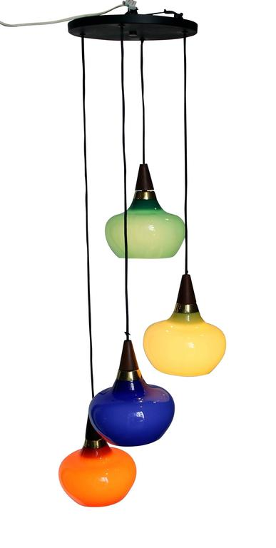 Interesting 1950s suspension in colored glass, wood and metal. In good original condition.