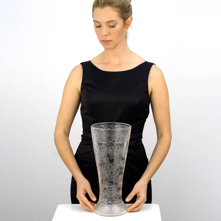 Circa 1900, by Thomas Webb, England. This stunning rock crystal vase by Thomas Webb is engraved in an exquisite Art Nouveau motif, showcasing profuse blossoms, twining vines, and draping boughs. At 13 1/2 inches tall, this is a large, rare, and
