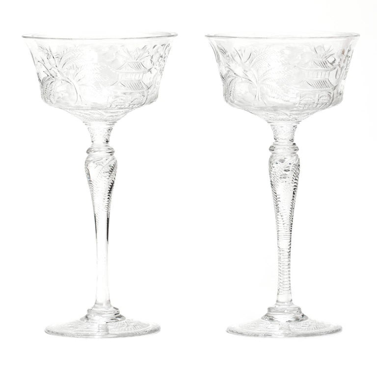 "Circa 1910, Stevens & Williams, England. These outstanding champagne or cocktail glasses by Stevens and Williams, in the rare and desirable ""Willow"" pattern, are ornamented with a beautiful chinoiserie scene featuring pagodas and ships. Splendidly"