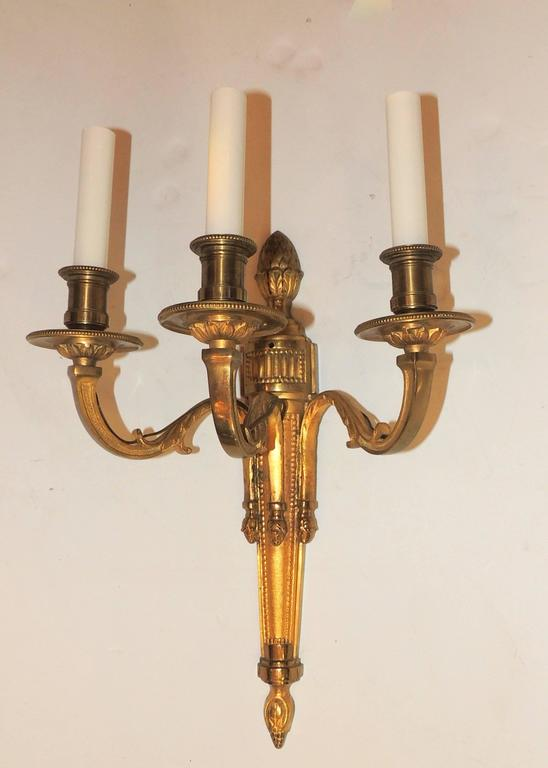 Wonderful pair of neoclassical urn top three-arm sconces with fine etched detail to bobeches, newly rewired. In the manner of Caldwell    Measures: 19