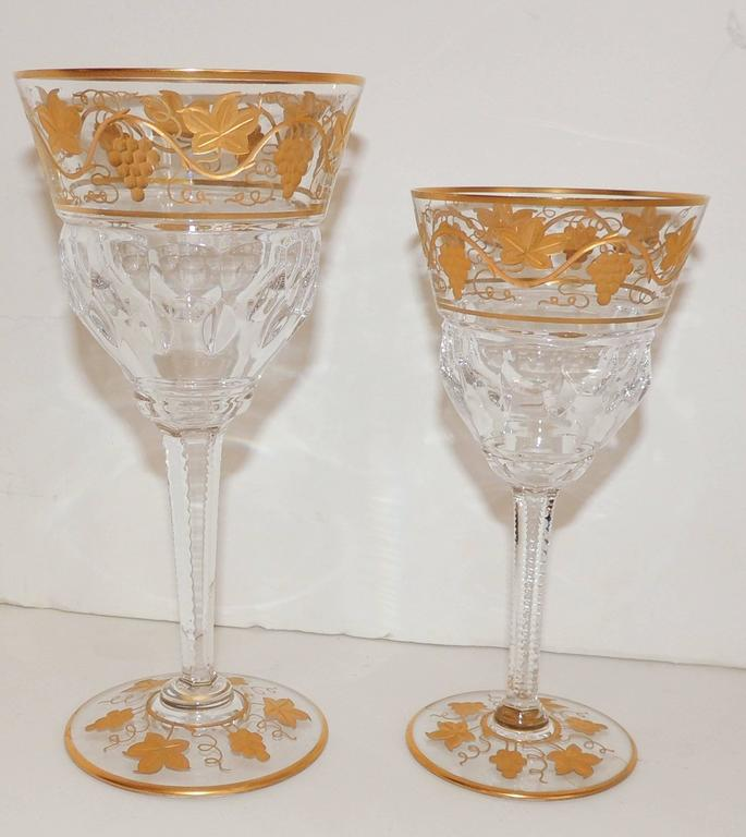 Wonderful set of goblets, stemware by Val St. Lambert Pampre D'Or pattern, circa 1930s. Gilt vine design water and wine glasses from Belgium.  Measures: 11 Wine 6.38