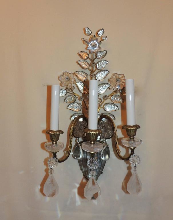 "A wonderful pair of vintage baguès style rock crystal and gilt bronze Jansen manner urn form flower spray three-light sconces.   Measures: 19"" H x 10.5"" Wx 8"" D."
