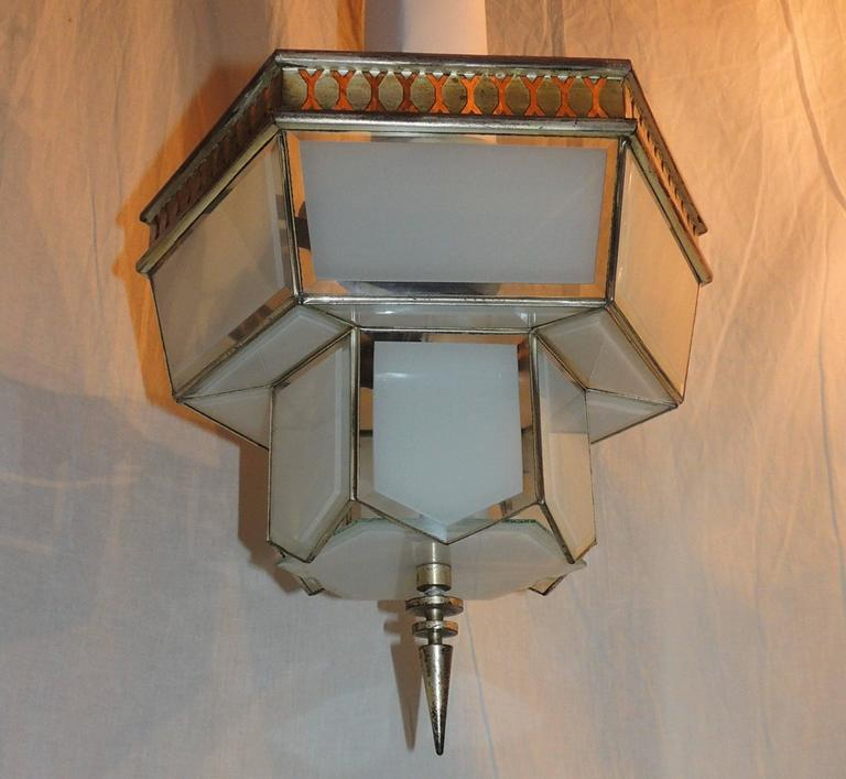 Wonderful Art Deco two-light fixture with beveled clear to frosted glass panels and original trim surrounding the top flush mount fixture.  Measures: 14