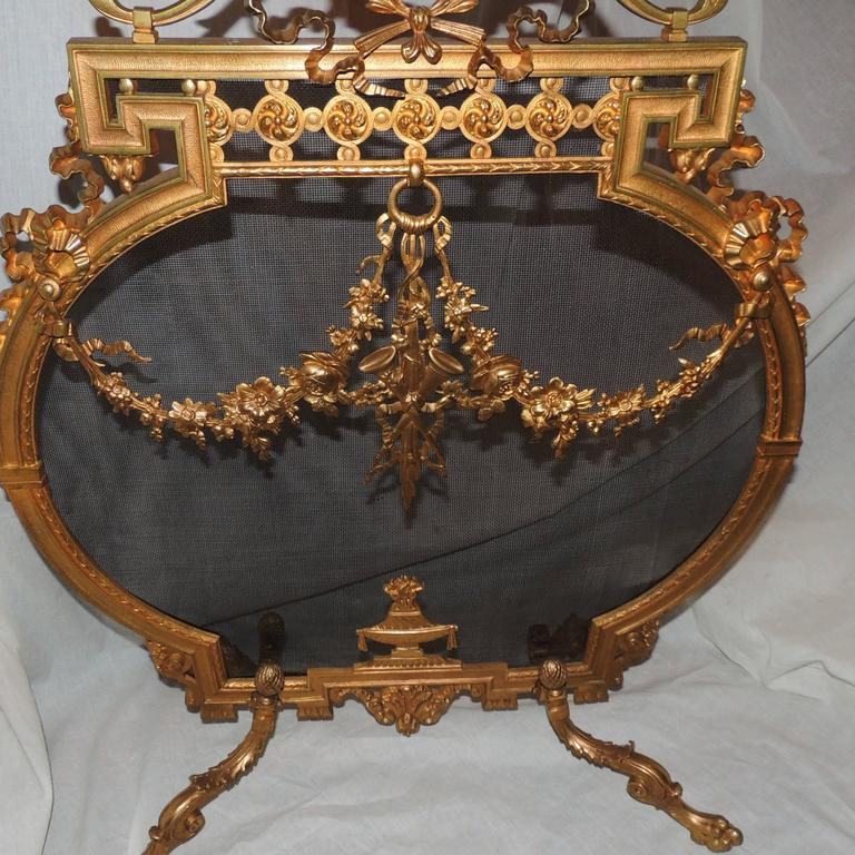 wonderful french dor bronze fireplace screen with ribbons medallion firescreen for sale at 1stdibs. Black Bedroom Furniture Sets. Home Design Ideas