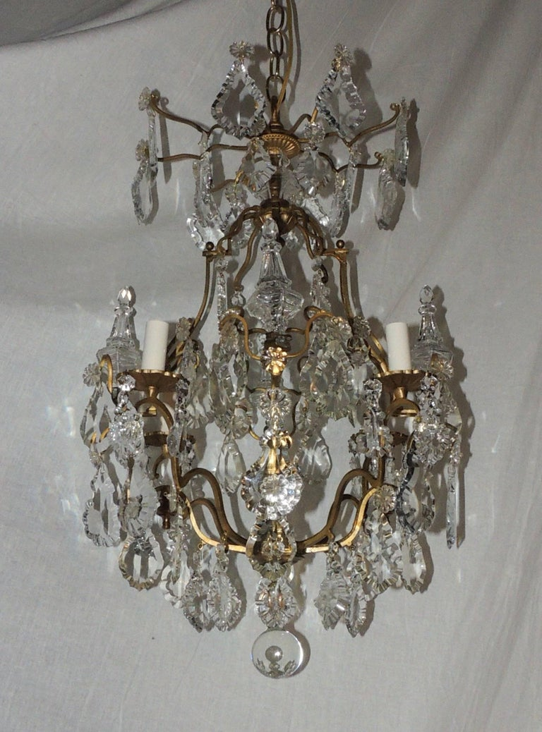 Wonderful petite french bronze gilt crystal four light chandelier a lovely petite french four light gilt chandelier decorated with flat bevelled crystals and obelisk arubaitofo Images