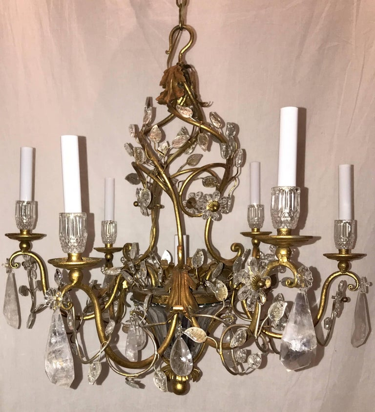 A Beautiful French gold gilt midcentury Bagues style, rock crystal and leaf basket form chandelier with six candelabra lights  Actual measurements:  27