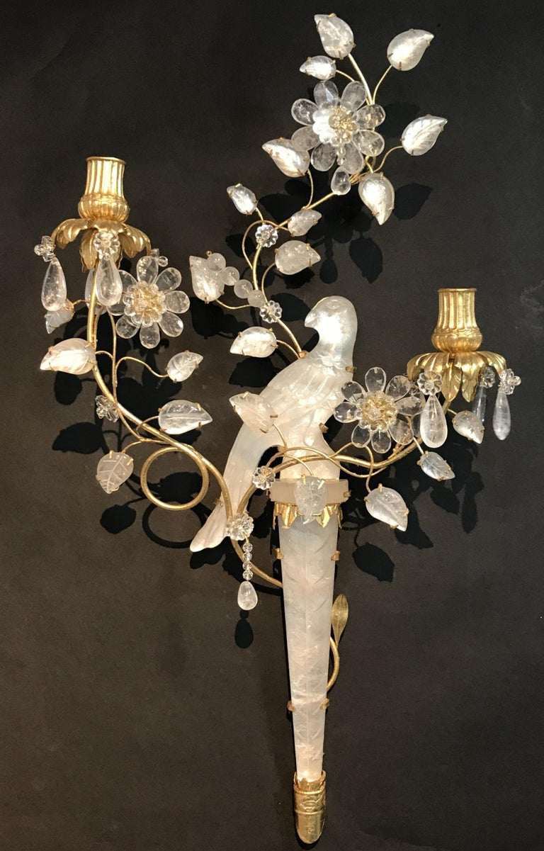 A wonderful pair of chinoiserie style rock crystal two-arm with gold gilt bird and flower form sconces facing one another.
