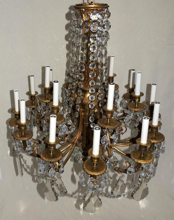 Beautiful French Empire doré bronze and draped crystal eighteen-light chandelier fixture.