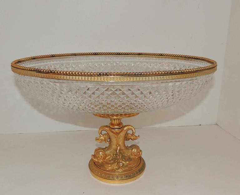 Wonderful French cut crystal and dorégilt bronze very fine dolphin motif oval centerpiece finished off with a beaded bronze rim on top.