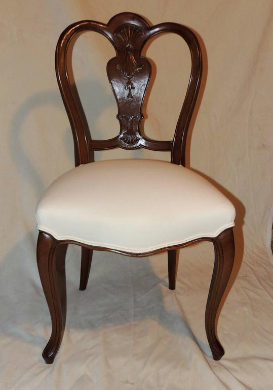 Wonderful shield back set of six French leg carved back side upholstered chairs recently refinished.  Measures: 19