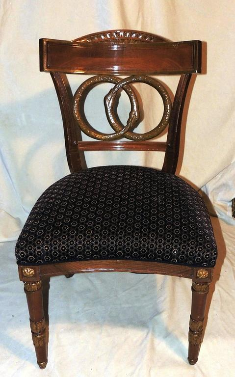 Two pairs of chairs with wonderful Empire carved back Motif of two swans and carved Medallion details on The legs.  Measures: 21