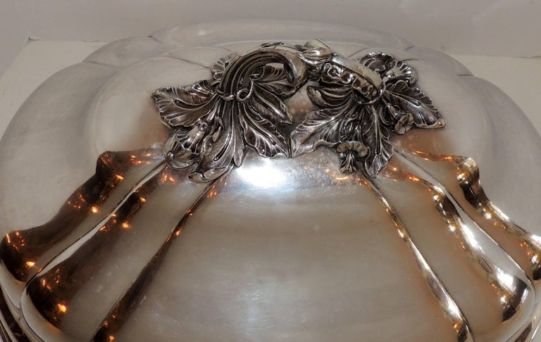 A rare and wonderful silver plated extra large antique serving meat food turkey dome / cover, in the Victorian style with a beautiful intricate handle. Finished with a wonderful lion crest on one side.