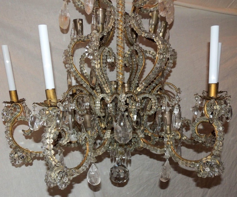 A wonderful large french bronze and beaded crystal with rock crystal accents in the manner of Maison Bagues with 6 arms and 36 lights in total this chandelier will light up any room in your home with elegance.