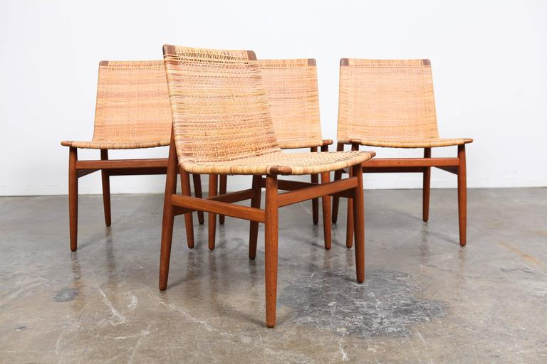 Set of four teak danish dining chairs by jorgen h j for for Dscan dining room set