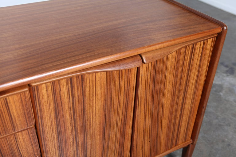 Mid-20th Century British Four-Door Four-Drawer Tola Sideboard by Elliots of Newbury For Sale