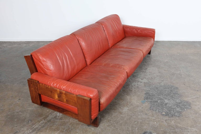 Red leather, three-seat sofa by Torbjørn Afdal of Norway.