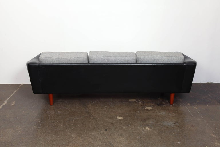 Danish Mid-Century Modern Black Leather Tuxedo Sofa by Illum Wikkelso In Good Condition For Sale In North Hollywood, CA
