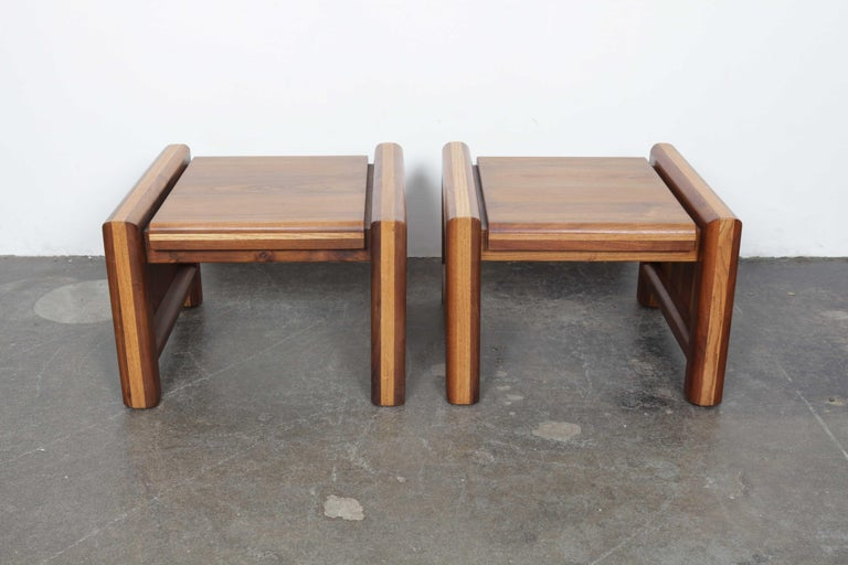 Pair of American made 1970s multi-tone walnut end tables with rounded chunky legs and solid sides. Designer and maker are unknown.