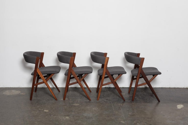 Danish Mid-Century Modern 1950s wraparound curved back teak dining chairs with 'A' frame and upholstered back and seat. These have been newly refinished in a natural teak oil finish and have been upholstered in a dark grey heavy linen fabric.