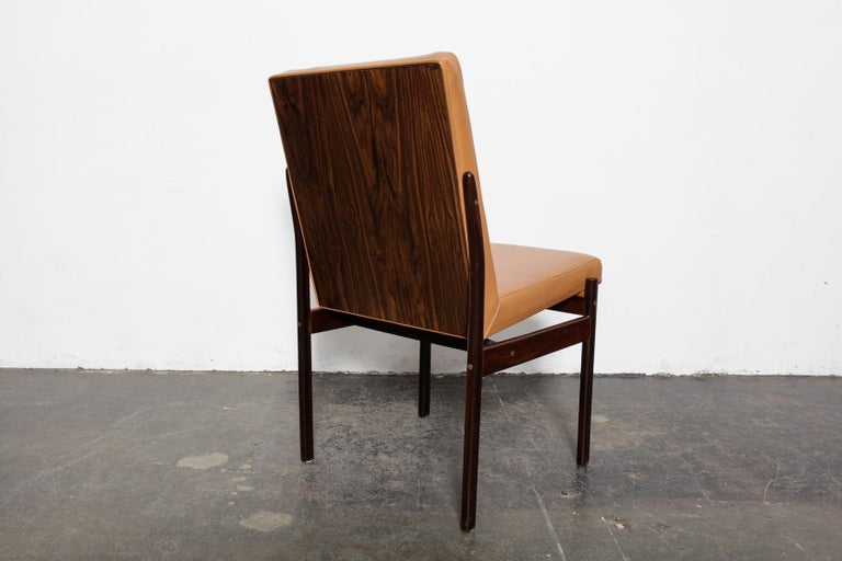Set of 8 tall back beautiful vintage Brazilian solid rosewood dining chairs, newly upholstered in a burnt orange leather and refinished in lacquer, Brazil, 1960s. Designer unknown.