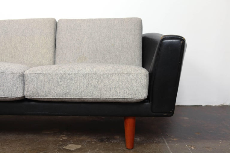Danish Mid-Century Modern Black Leather Tuxedo Sofa by Illum Wikkelso For Sale 1