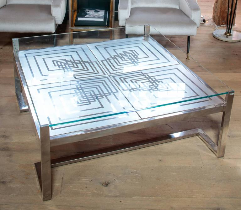 Beautiful 1970s Romeo Rega coffee table in stainless steel and glass with beautiful etching. Designer's insignia in the corner.