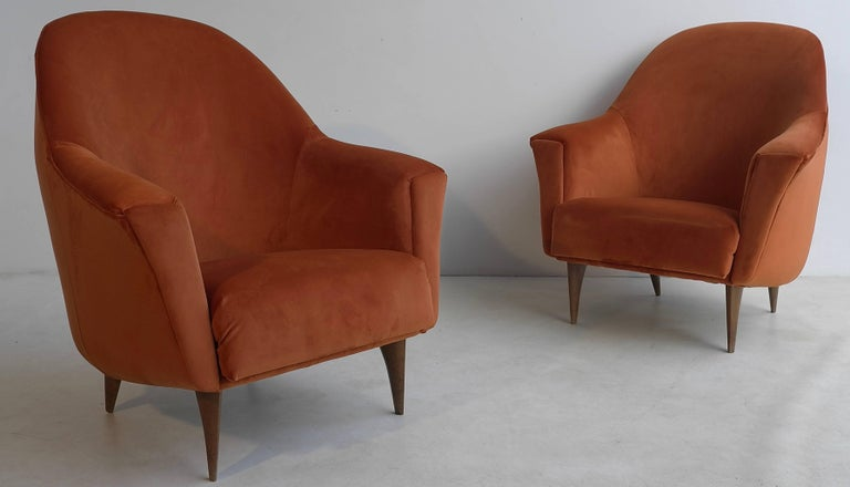 Pair of armchairs in red terra velvet style with beautiful shaped wooden legs, Italy, 1950s.