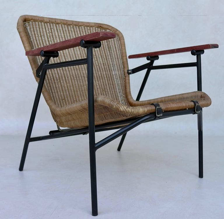 Rare dirk van Sliedregt armchair in Rattan and steel secured with three black leather straps.