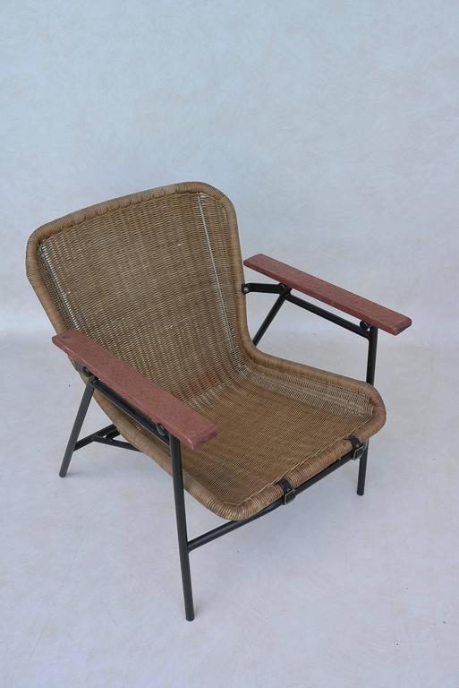 Leather Rare dirk van Sliedregt Armchair in Rattan and Steel For Sale