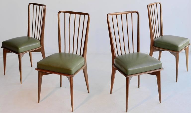 Set of four Paolo Buffa wooden dining chairs with the original green seats.