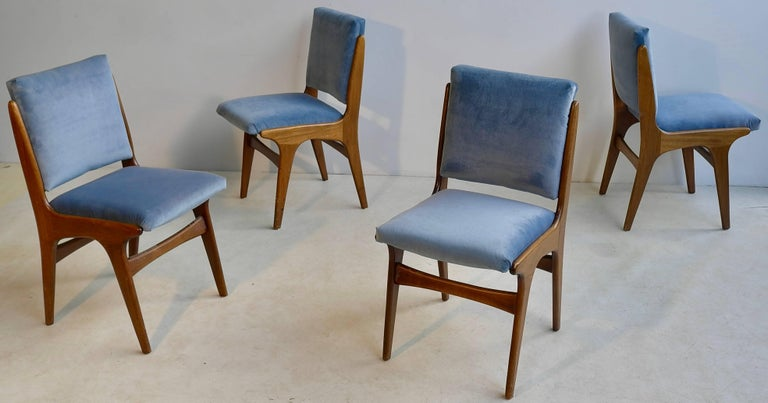 Four dining chairs in ice blue velvet in style of Carlo di Carli, Italy, 1950s.
