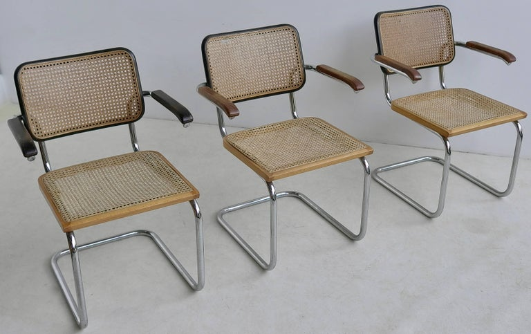 The S64 chair was designed by Marcel Breuer for Thonet in 1929. These original Thonet chairs are made of chrome-plated tubular steel, dark brown and natural bentwood and a cane finish. Rare in this wood/color combination. These are early produced