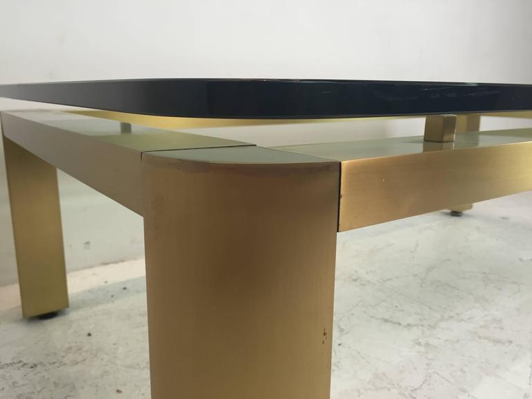 A stylish 1970s brushed brass coffee table with floating glass top. The brass has a wonderful shimmer effect. The table has been well cared for from it's original owner and in excellent vintage condition.