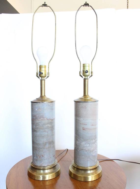 Pair of marble lamps with brass accents.