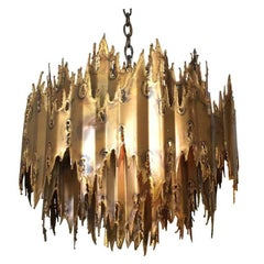 Torch Cut Brutalist Chandelier by Tom Greene (1 Available)